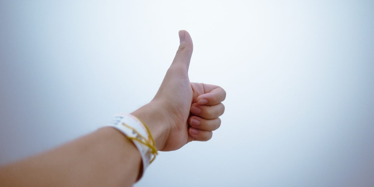 person-doing-thumbs-up-193821