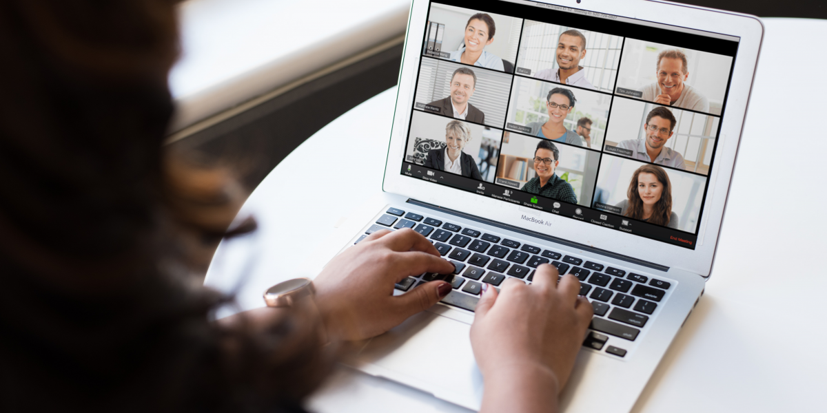 a computer that has 9 people on the screen having a virtual meeting